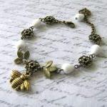 Antiqued gold bee bracelet Czech wh..