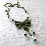 Bow necklace clear faceted teardrop..