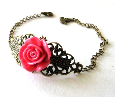 Fuchsia pink resin flower bracelet jewelry with bronzed filigree and bird charm
