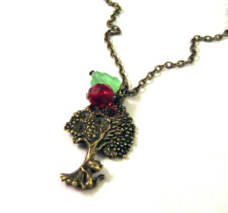 Antiqued bronze cat necklace jewelry with red bead and green leaf - Cat behind a tree necklace