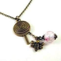 Lollipop and bronzed bee necklace jewelry with pink glass bead